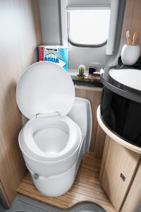 C223-CS Toilet installed in vehicle, raised lid